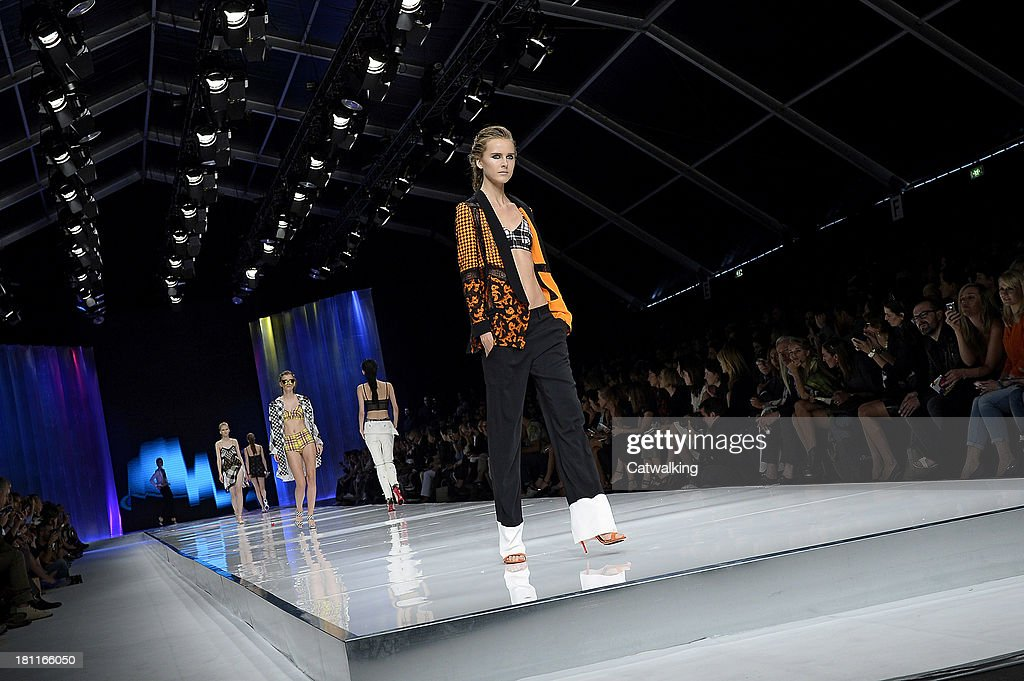 A model walks the runway at the Just Cavalli Spring Summer 2014 fashion show during Milan Fashion Week on September 19, 2013 in Milan, Italy.