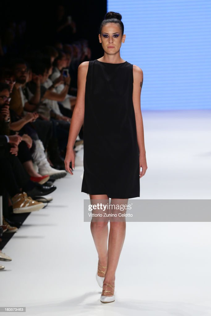 A model walks the runway at the Kaf Dan By Elaidi show during Mercedes-Benz Fashion Week Istanbul s/s 2014 presented by American Express on October 7, 2013 in Istanbul, Turkey.