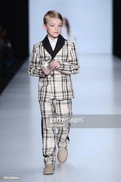 A model walks the runway at the Karchenkova And Bykovskaya show for Contrfashion Karchenkova during MercedesBenz Fashion Week Russia Fall/Winter...