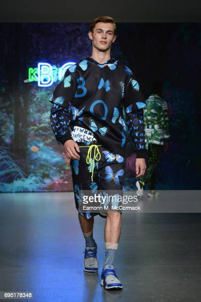A model walks the runway at the Katie Eary show during the London Fashion Week Men's June 2017 collections on June 12 2017 in London England