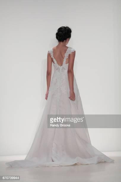 A model walks the runway at the Kelly Faetanini Runway show Spring 2018 season during New York Fashion Week Bridal April 2017 at EZ Studios on April...