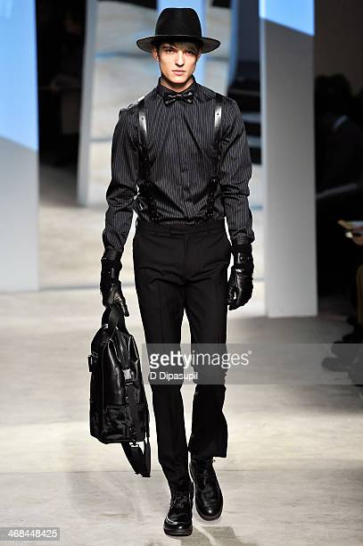 A model walks the runway at the Kenneth Cole Collection fashion show during MercedesBenz Fashion Week Fall 2014 at The Garage By Kenneth Cole on...