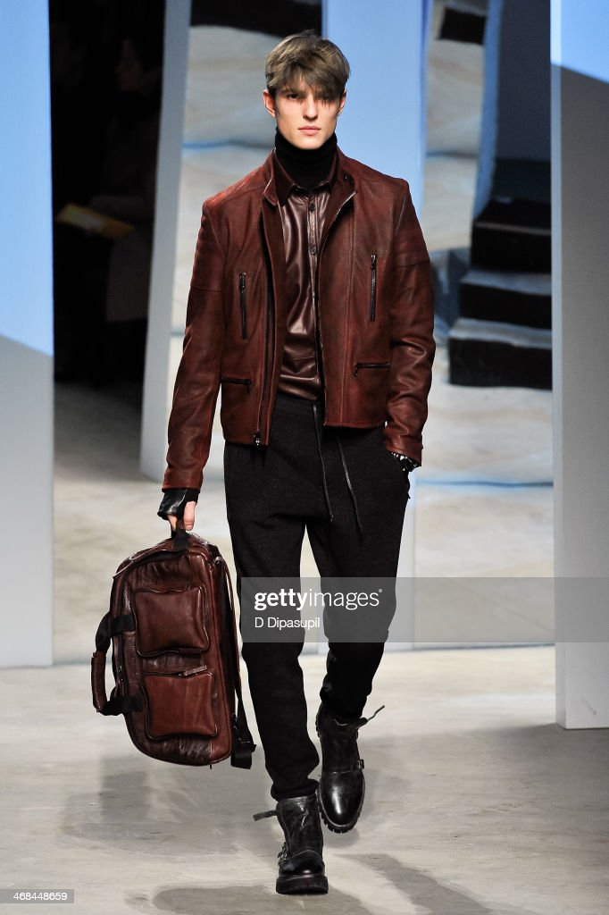 A model walks the runway at the Kenneth Cole Collection fashion show during Mercedes-Benz Fashion Week Fall 2014 at The Garage By Kenneth Cole on February 10, 2014 in New York City.