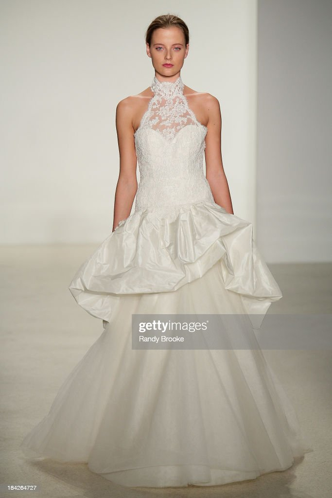 A model walks the runway at the Kenneth Pool Fall 2014 Bridal collection show on October 12, 2013 in New York City.