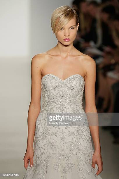 A model walks the runway at the Kenneth Pool Fall 2014 Bridal collection show on October 12 2013 in New York City