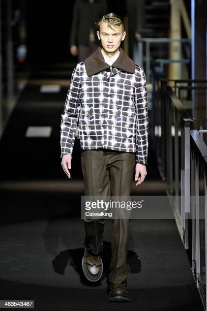 A model walks the runway at the Kenzo Autumn Winter 2014 fashion show during Paris Menswear Fashion Week on January 18 2014 in Paris France