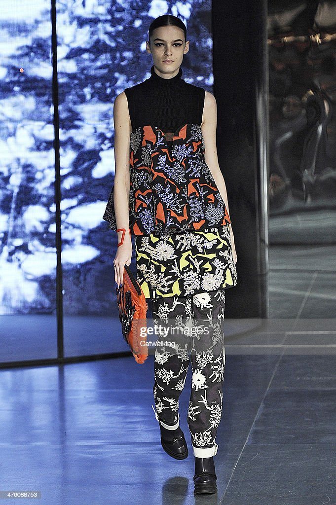 A model walks the runway at the Kenzo Autumn Winter 2014 fashion show during Paris Fashion Week on March 2 2014 in Paris France