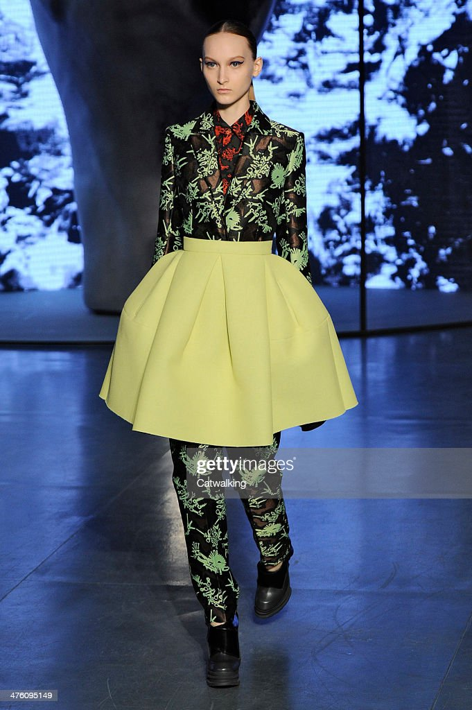 A model walks the runway at the Kenzo Autumn Winter 2014 fashion show during Paris Fashion Week on March 2, 2014 in Paris, France.