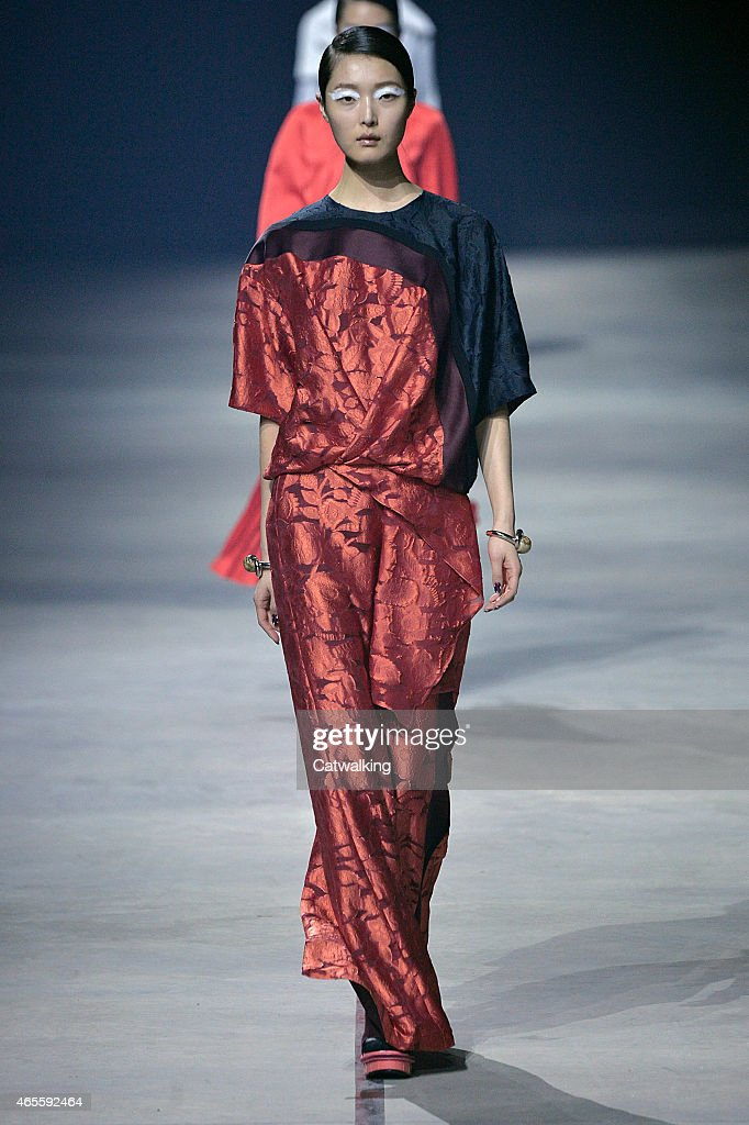 A model walks the runway at the Kenzo Autumn Winter 2015 fashion show during Paris Fashion Week on March 8 2015 in Paris France
