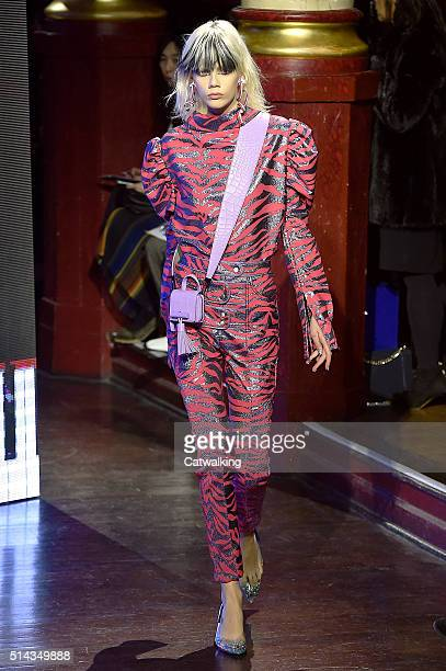 A model walks the runway at the Kenzo Autumn Winter 2016 fashion show during Paris Fashion Week on March 8 2016 in Paris France
