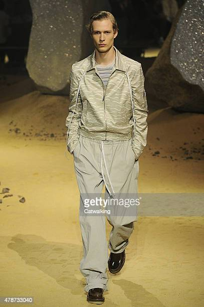 A model walks the runway at the Kenzo Spring Summer 2016 fashion show during Paris Menswear Fashion Week on June 27 2015 in Paris France