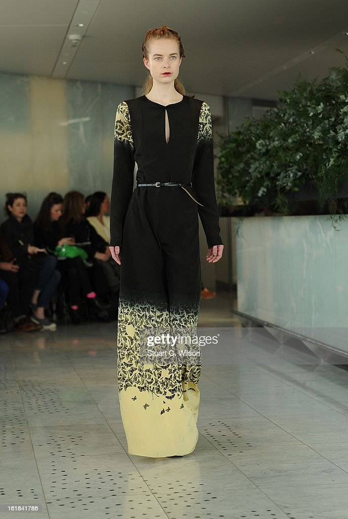 A model walks the runway at the Kinder Aggugini salon show during London Fashion Week Fall/Winter 2013/14 at on February 17, 2013 in London, England.