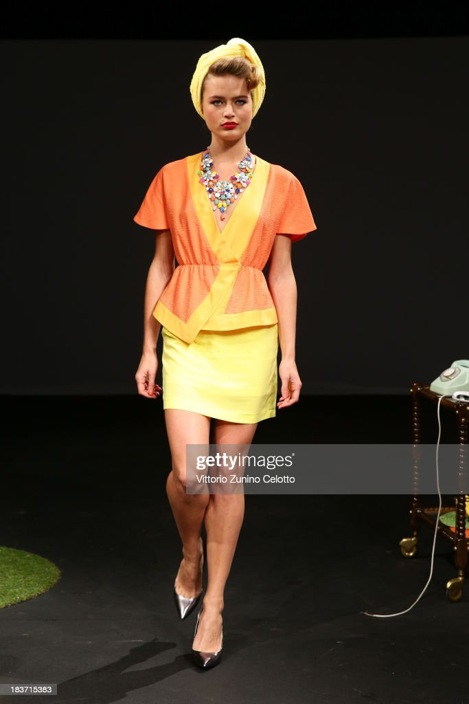 A model walks the runway at the Kith & Kin show during Mercedes-Benz Fashion Week Istanbul s/s 2014 presented by American Express on October 9, 2013 in Istanbul, Turkey.