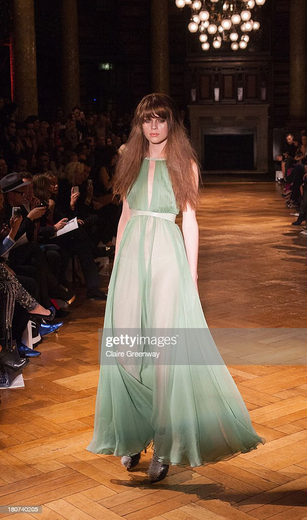 A model walks the runway at the Kristian Aadnevik show during London Fashion Week SS14 at The Royal Horseguards on September 15, 2013 in London, England.>>