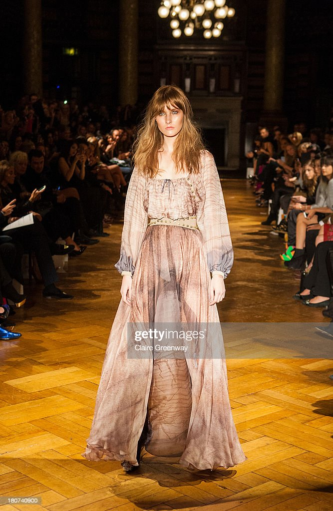 A model walks the runway at the Kristian Aadnevik show during London Fashion Week SS14 at The Royal Horseguards on September 15, 2013 in London, England.