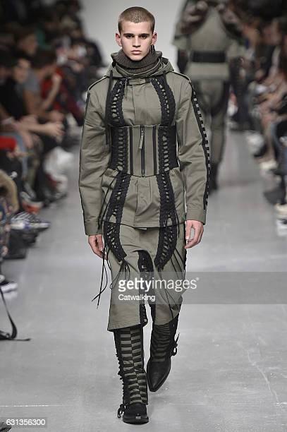A model walks the runway at the KTZ Autumn Winter 2017 fashion show during London Menswear Fashion Week on January 8 2017 in London United Kingdom