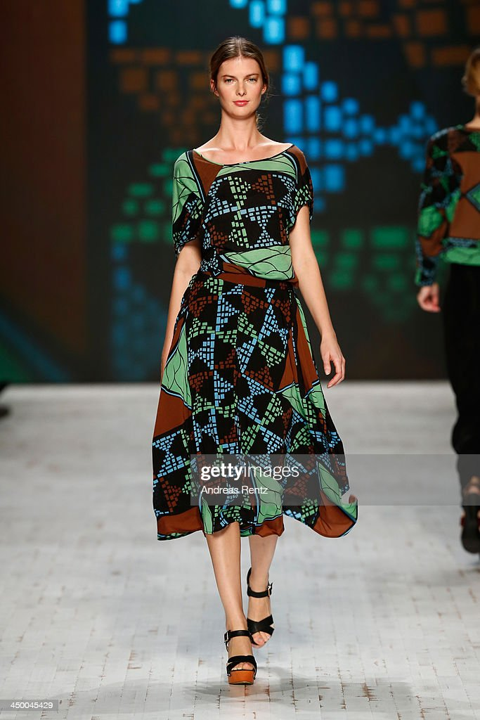 A model walks the runway at the Laend Phungkit show during Mercedes-Benz Fashion Days Zurich 2013 on November 16, 2013 in Zurich, Switzerland.