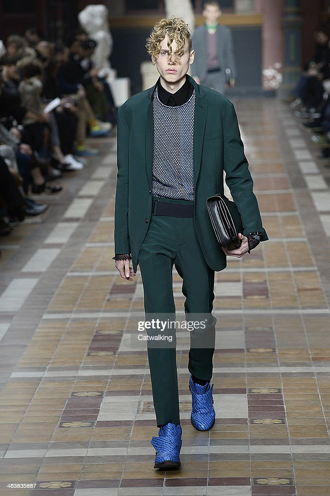 A model walks the runway at the Lanvin Autumn Winter 2014 fashion show during Paris Menswear Fashion Week on January 19, 2014 in Paris, France.