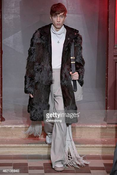 A model walks the runway at the Lanvin Autumn Winter 2015 fashion show during Paris Menswear Fashion Week on January 25 2015 in Paris France