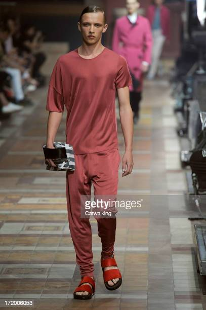 A model walks the runway at the Lanvin Spring Summer 2014 fashion show during Paris Menswear Fashion Week on June 30 2013 in Paris France