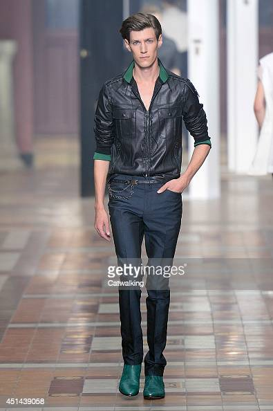 A model walks the runway at the Lanvin Spring Summer 2015 fashion show during Paris Menswear Fashion Week on June 29 2014 in Paris France
