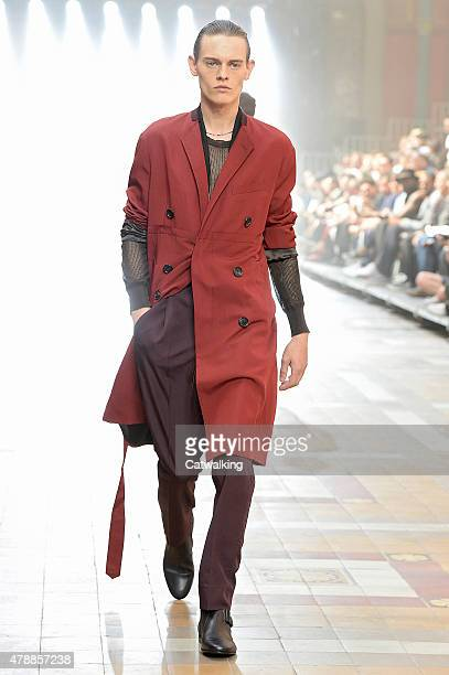 A model walks the runway at the Lanvin Spring Summer 2016 fashion show during Paris Menswear Fashion Week on June 28 2015 in Paris France