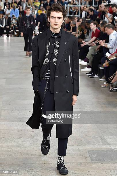 A model walks the runway at the Lanvin Spring Summer 2017 fashion show during Paris Menswear Fashion Week on June 26 2016 in Paris France