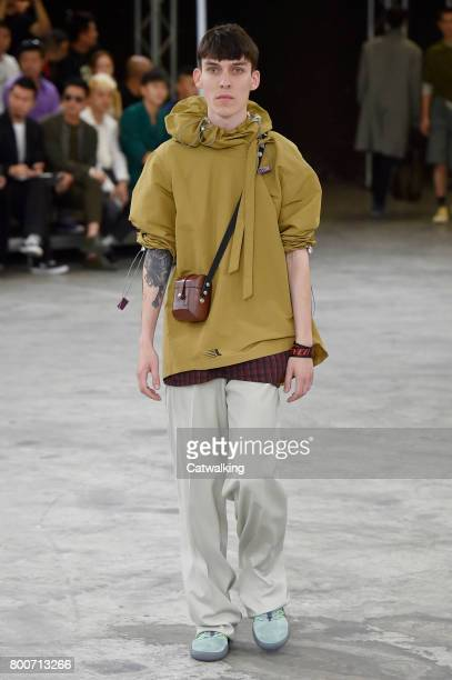A model walks the runway at the Lanvin Spring Summer 2018 fashion show during Paris Menswear Fashion Week on June 25 2017 in Paris France