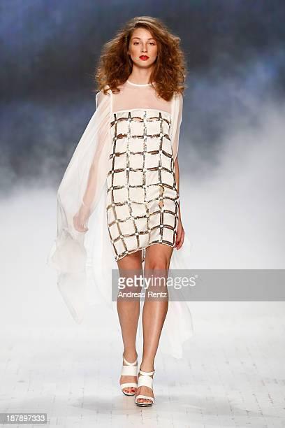 A model walks the runway at the LBD White show during MercedesBenz Fashion Days Zurich 2013 on November 13 2013 in Zurich Switzerland
