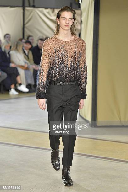 A model walks the runway at the Lemaire Autumn Winter 2017 fashion show during Paris Menswear Fashion Week on January 18 2017 in Paris France