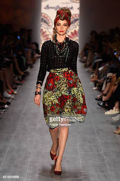 A model walks the runway at the Lena Hoschek show during the MercedesBenz Fashion Week Spring/Summer 2015 at Erika Hess Eisstadion on July 8 2014 in...