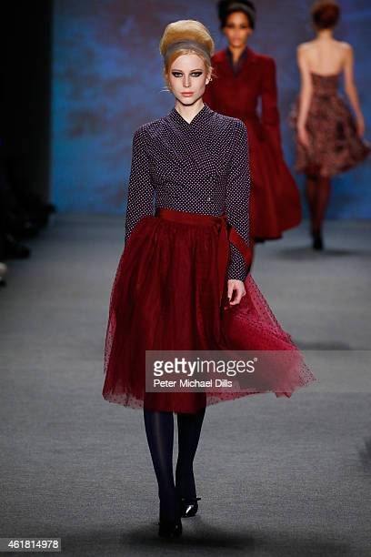 A model walks the runway at the Lena Hoschek show during the MercedesBenz Fashion Week Berlin Autumn/Winter 2015/16 at Brandenburg Gate on January 20...