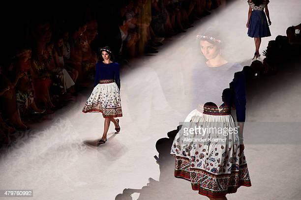 A model walks the runway at the Lena Hoschek show during the MercedesBenz Fashion Week Berlin Spring/Summer 2016 at Brandenburg Gate on July 7 2015...