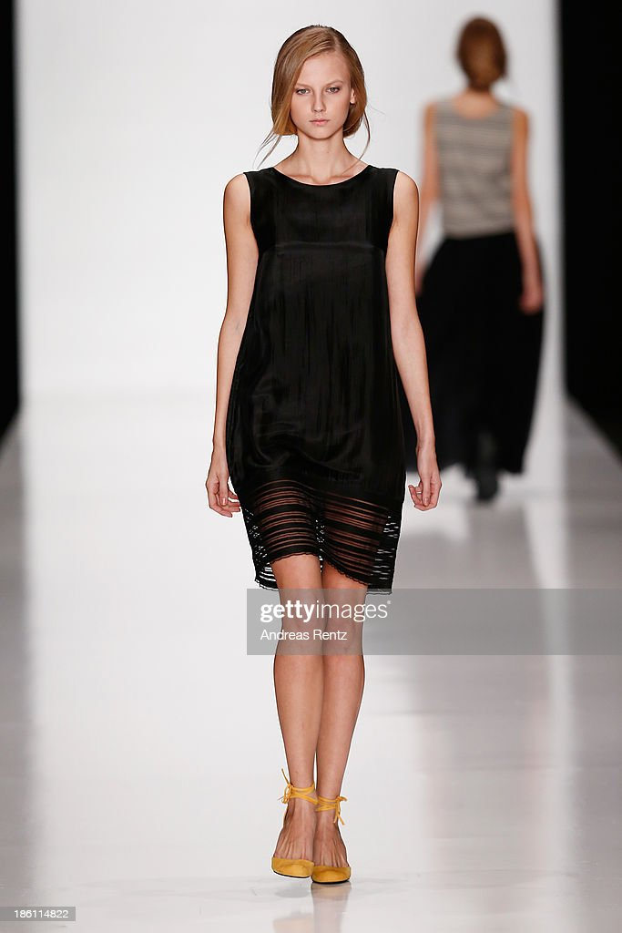 A model walks the runway at the Lena Tsokalenko show during Mercedes-Benz Fashion Week Russia S/S 2014 on October 28, 2013 in Moscow, Russia.