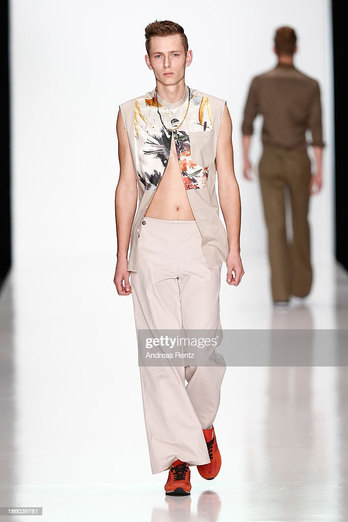 A model walks the runway at the Leonid Alexeev show during Mercedes-Benz Fashion Week Russia S/S 2014 on October 27, 2013 in Moscow, Russia.