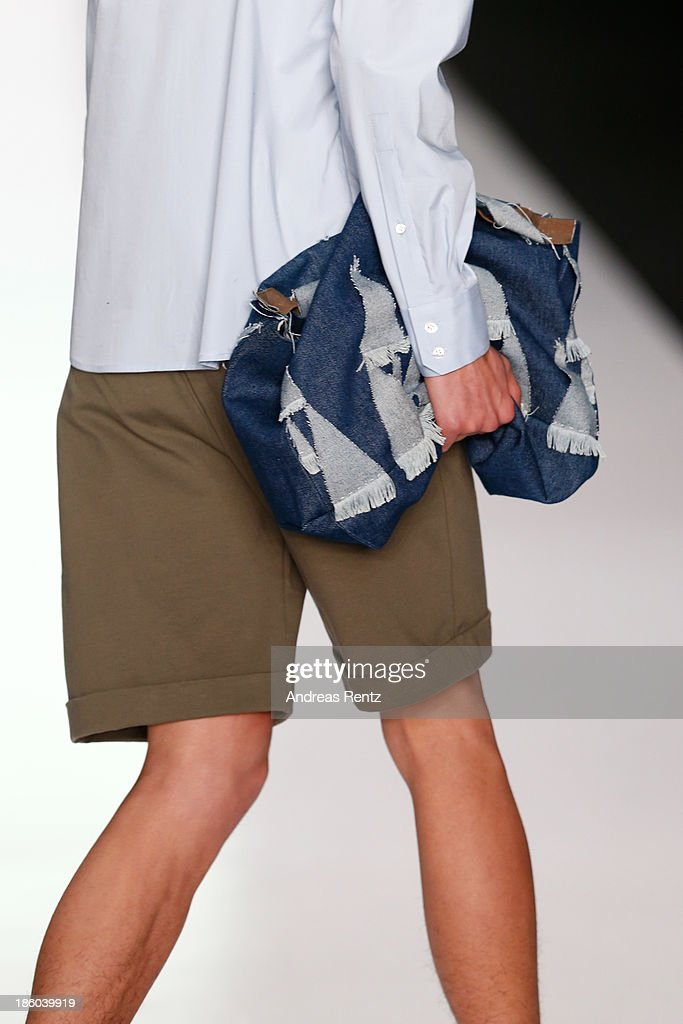A model walks the runway (detail) at the Leonid Alexeev show during Mercedes-Benz Fashion Week Russia S/S 2014 on October 27, 2013 in Moscow, Russia.