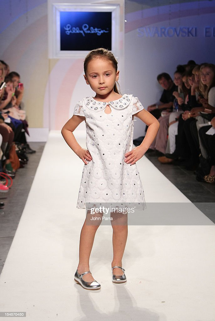 A model walks the runway at the Lilly Pulitzer show during the Swarovski Elements at Petite Parade NY Kids Fashion Week In Collaboration With VOGUEbambini - Day 2 at Industria Superstudio on October 21, 2012 in New York City.