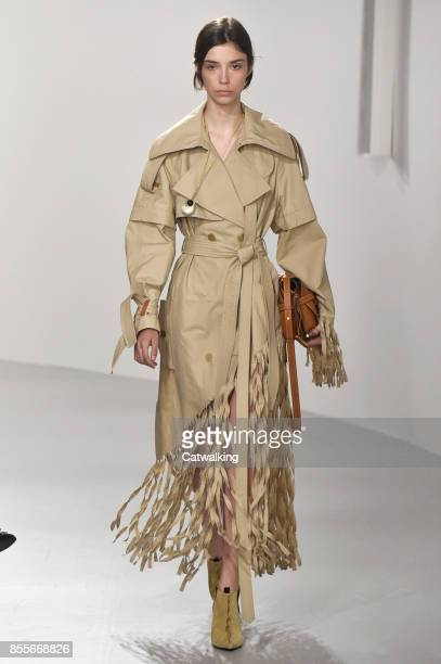 A model walks the runway at the Loewe Spring Summer 2018 fashion show during Paris Fashion Week on September 29 2017 in Paris France