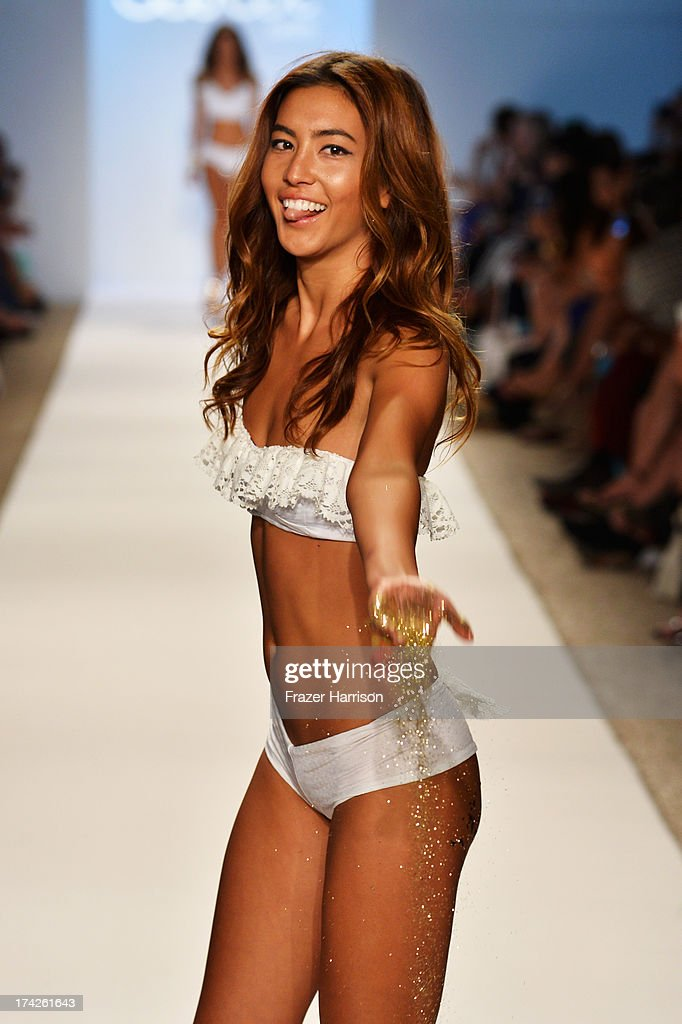 A model walks the runway at the Lolli Swim show during Mercedes-Benz Fashion Week Swim 2014 at Cabana Grande at the Raleigh on July 22, 2013 in Miami, Florida.