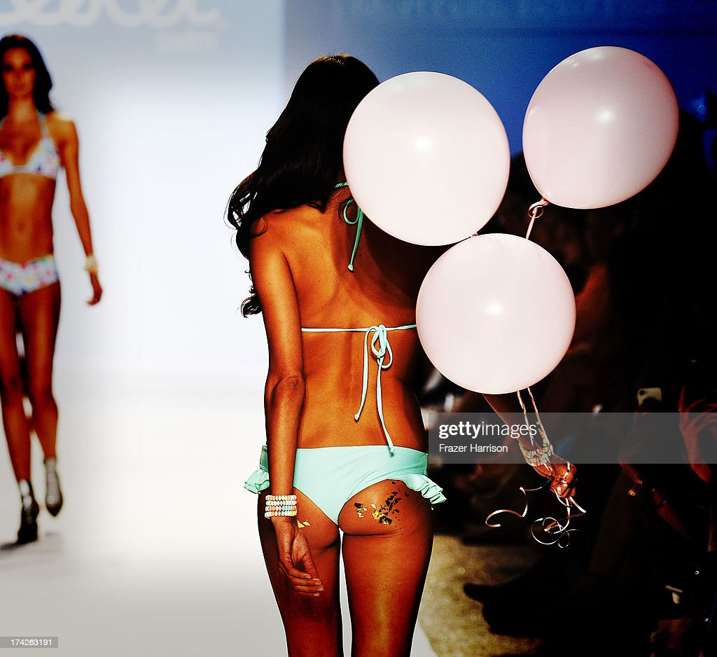 A model walks the runway at the Lolli Swim show during Mercedes-Benz Fashion Week Swim 2014 at the Raleigh on July 22, 2013 in Miami Beach, Florida.