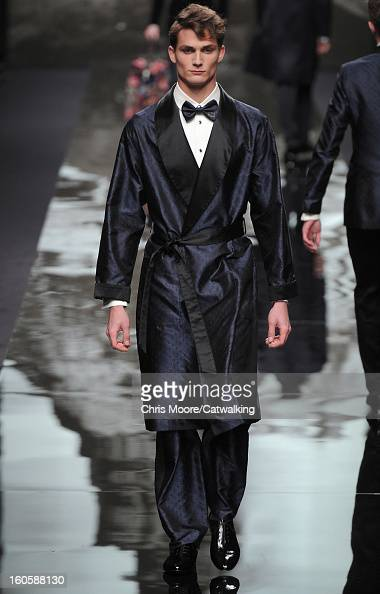 A model walks the runway at the Louis Vuitton Autumn Winter 2013 fashion show during Paris Menswear Fashion Week on January 17 2013 in Paris France