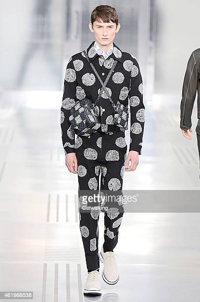 A model walks the runway at the Louis Vuitton Autumn Winter 2015 fashion show during Paris Menswear Fashion Week on January 22 2015 in Paris France
