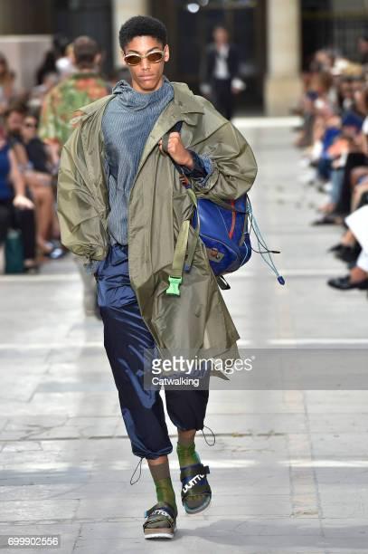 A model walks the runway at the Louis Vuitton Spring Summer 2018 fashion show during Paris Menswear Fashion Week on June 22 2017 in Paris France