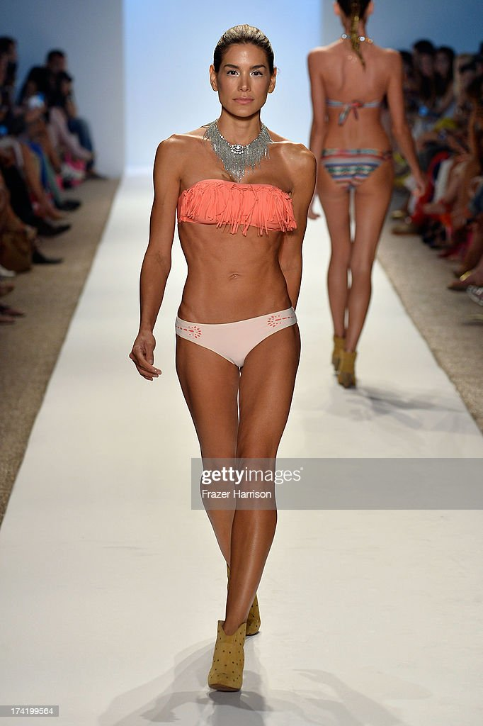 A model walks the runway at the L*Space By Monica Wise show during Mercedes-Benz Fashion Week Swim 2014 at Cabana Grande at the Raleigh on July 21, 2013 in Miami, Florida.