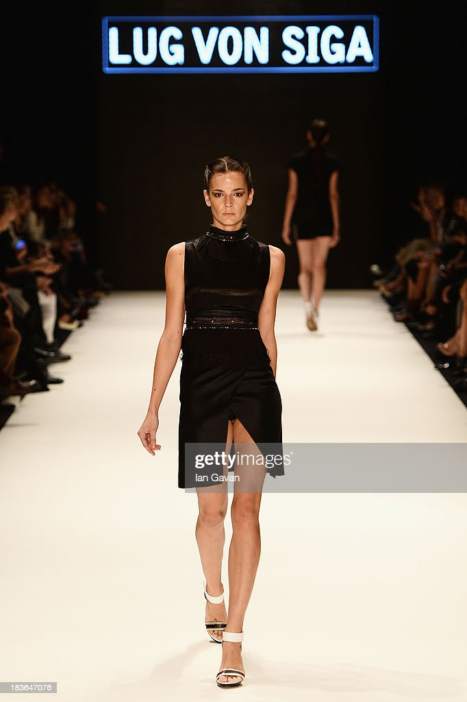 A model walks the runway at the Lug Von Siga show during Mercedes-Benz Fashion Week Istanbul s/s 2014 presented by American Express on October 8, 2013 in Istanbul, Turkey.