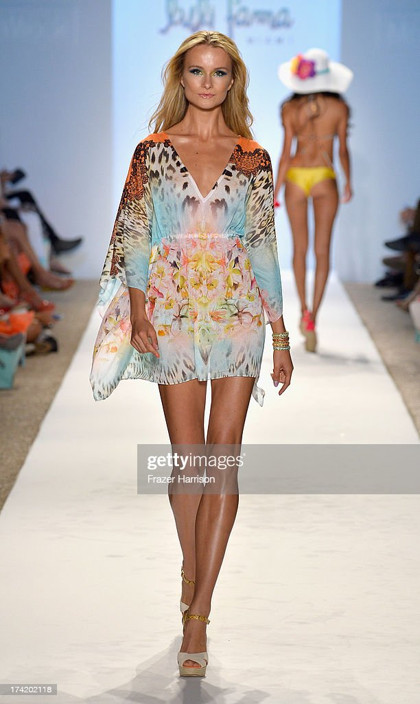 A model walks the runway at the Luli Fama show during Mercedes-Benz Fashion Week Swim 2014 at Cabana Grande at the Raleigh on July 21, 2013 in Miami, Florida.