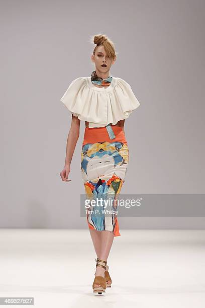 A model walks the runway at the Lulu Liu show at the Fashion Scout venue during London Fashion Week AW14 at Freemasons Hall on February 14 2014 in...