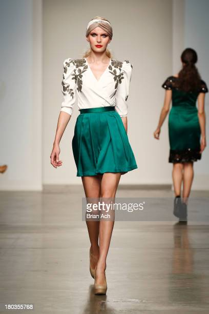 A model walks the runway at the Lum By Lama Taher show during Nolcha Fashion Week New York Spring/Summer 2014 presented by RUSK at Pier 59 Studios on...