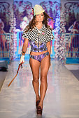 A model walks the runway at the Maaji Swimwear fashion show during MercedesBenz Fashion Week Swim 2015 at The Raleigh at Raleigh Hotel on July 19...