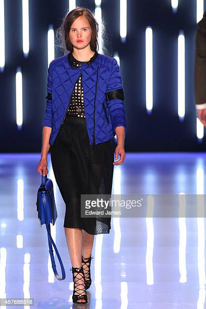 A model walks the runway at the Mackage Spring/Summer 2015 fashion show during World Mastercard Fashion Week at David Pecaut Square on October 22...